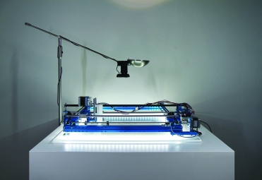 Figure 3: Drawing machine with under-frame LEDs illuminated.