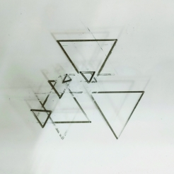 Figure 17: Initial drawing by the machine. The smaller triangles are results of the machine recognizing lines that it failed to completely erase earlier, resulting in the recognition of triangles that weren't technically predictable according to the computation.